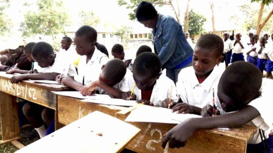 Students-writting-Annual-report-cards-Kambarage-Primary-School
